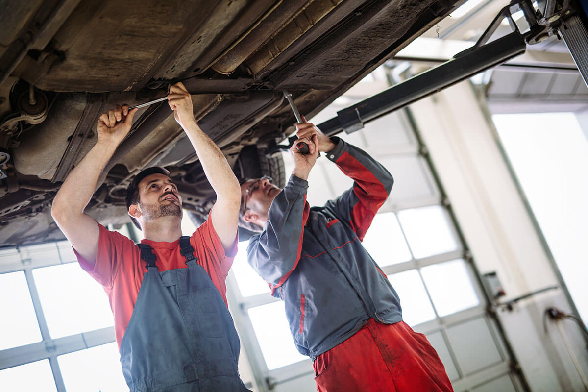 Mechanics wearing matching uniforms
