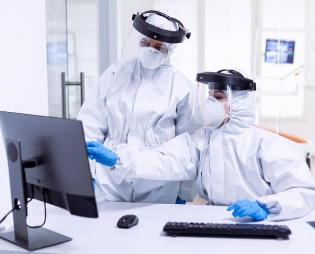 doctor and nurse in PPE suit