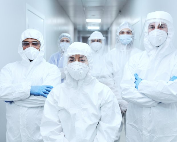 Doctors in protective uniforms at hospital